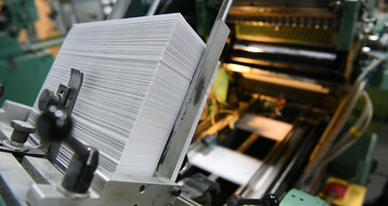 Stack of envelopes on a printer